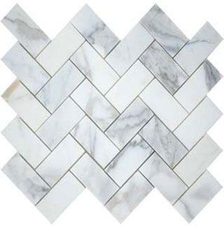 Backsplash used in kitchen.  Calacatta herringbone mosaic