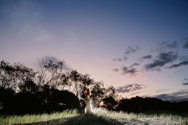 bride and groom beach wedding photos on sunset on sand dunes. Photography by The Arched Window.