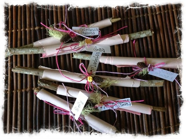 Invitations wrapped on a twig & decorated with a pinecone & moss.