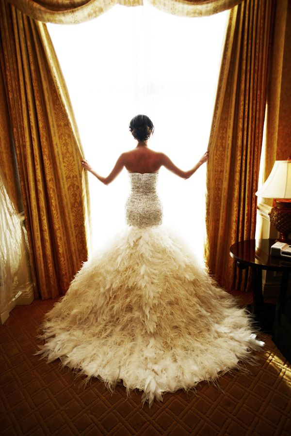 Dramatic Wedding Dress. Loves how it hugs the butt!