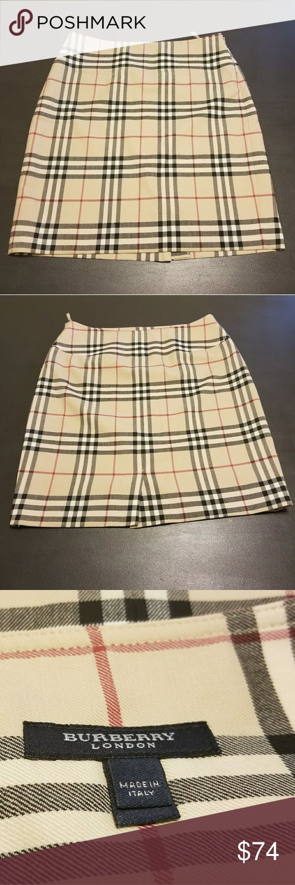 Burberry skirt Stylish Burberry skirt. Versatile piece. Good condition, with some very miniscule snags. Burberry Skirts Midi