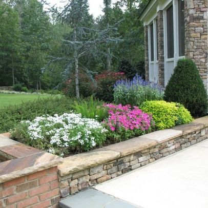 33 best images about yard planters on pinterest for Stone retaining wall design