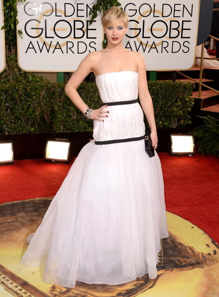 Fashion darling Jennifer Lawrence continued her red carpet winning streak in a black and white Dior gown, which she wore with tear-drop earrings and an arm full of bangles.