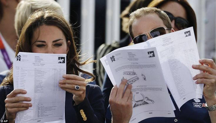 The Duchess of Cambridge and Prince William read a programme as they watch the equestrian eventing