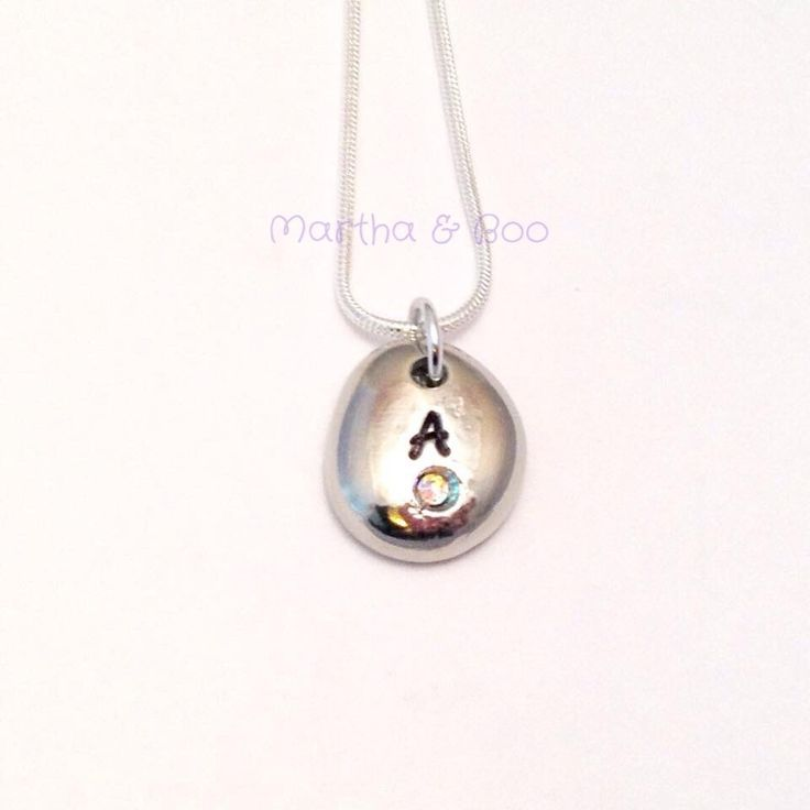Pewter monogram initial pebble necklace, pendant, hand stamped , with Swarovski elements by MarthaAndBoo on Etsy https://www.etsy.com/listing/228851466/pewter-monogram-initial-pebble-necklace