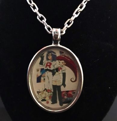 Pokemon Team Rocket and Meowth pendant necklace available at geek-chic.net!