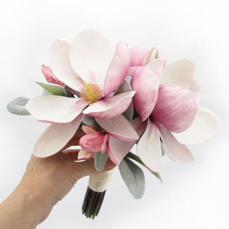 Simple and sweet for a junior bridesmaid - magnolias and lambs' ears foliage. Find your perfect wedding flowers at www.loveflowers.com.au