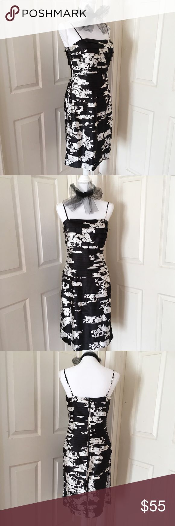 "Black & White Floral Cocktail Dress Tiered strips of soft satin fabric hug in all the right places for total figure flattery.  Features  fabric binding along the sides and the invisible zip in the back, adjustable shoulder straps, and a BUILT-IN-BRA(❤️ this!!)  GUC (very conservative estimate).   Approx. Finished Measurements:  B: 34""  W: 30""  H: 40""  L from W to hem: 25""  Pls carefully review pictures. Know your measurements. Feel free to ask any ❓'s. White House Black Market Dresses Midi"