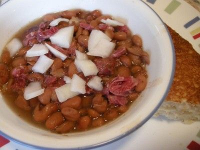 Crockpot Pinto Beans  These were delicious! I used a leftover honey baked ham bone, so they were on the sweet side. I added the onion in the beginning. And garlic. And bacon.