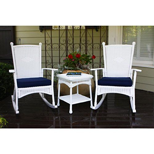 Tortuga Outdoor Classic Coastal White Rocking Chair Powder-coated steel Set (3-piece). Powder-coated steel frames. All-weather resin wicker. Resistant to stains, cracks, water and UV. Set includes 2 rocking chairs, 2 blue cushions, and 1 side table. Each chair measures 40 inches tall x 35 inches deep.