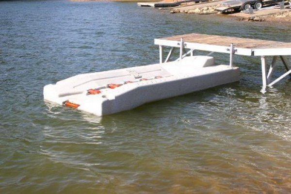 This Jetski Port, also known as PWC Port (Personal Water Craft Port), can handle most PWCs up to 1500 lbs. With its 6 rollers and easy installation, it's the best way to roll up onto your dock. Self-centering entry rollers make docking easy. Filled with expanded polystyrene for positive buoyancy. Side- or front-mount hardware available. Colors: tan or gray speckle. Comes standard with (6) rollers Includes tie down cleat with connection kit