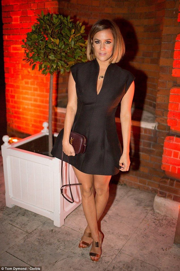 Gorgeous: Caroline Flack put on a leggy display in a black skater-style dress as she atten...