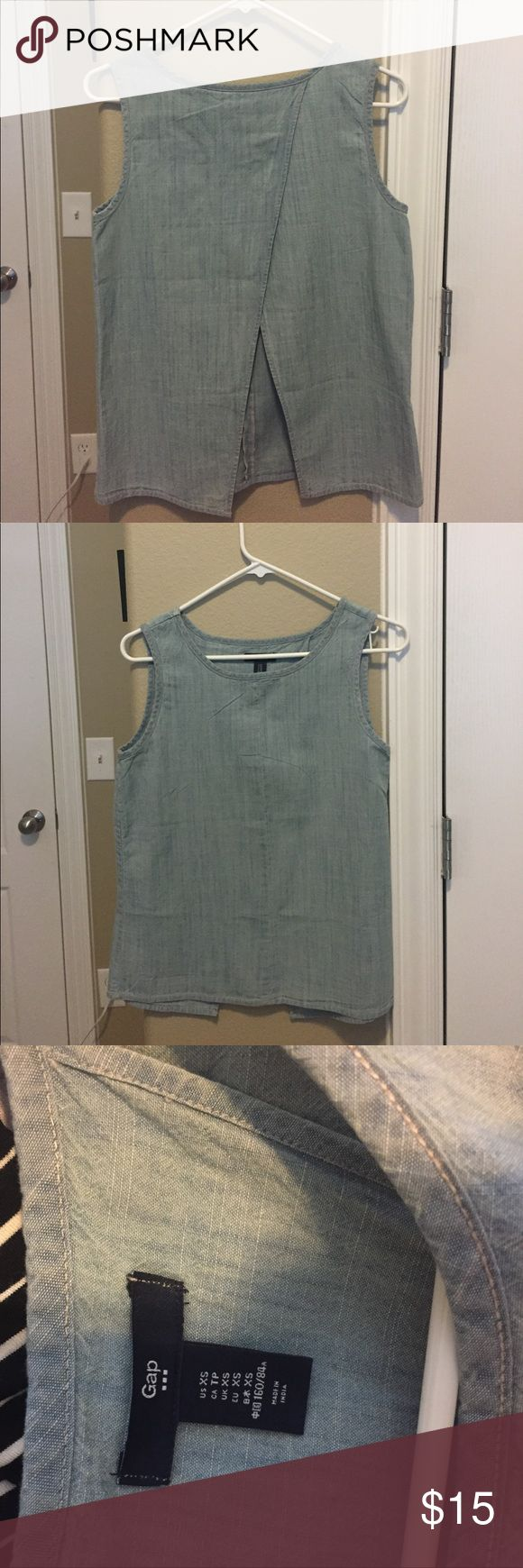 """Open back denim top Adorable GAP light denim """"peek"""" open back tank top. So cute and only worn once. Pair with a great bandeau top for summer! GAP Tops Tank Tops"""