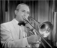 Tommy Dorsey  1905 – 1956 was an American jazz trombonist, trumpeter, composer, and bandleader of the Big Band era. Frank Sinatra achieved his first great success as a vocalist in the Dorsey band and claimed he learned breath control from watching Dorsey play trombone.