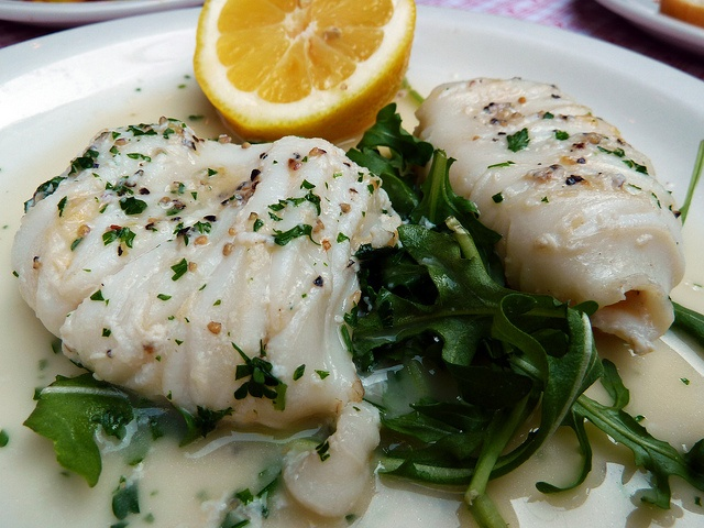 Gently sauteed Calamari served in a delicious lemon ...
