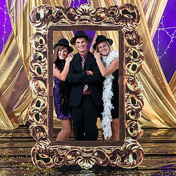 Our Gold Photo Frame Prop Standee has the look of a richly detailed photo frame with the center cut out for your guests.