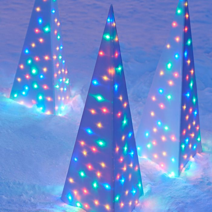 Make your home the most brilliant on the block with an easy DIY outdoor Christmas light project. A tall white pyramid by day, this Christmas decoration really shines at night from the glow of 100 LED lights.