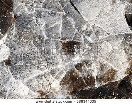 Frozen ice, winter and spring abstract background
