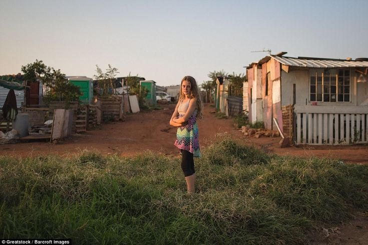 Jeanine Maritz, 13, stands down the road from her mother's makeshift home. She lives with her father and visits her mother and aunt in Munsieville squatter camp on weekends and holidays