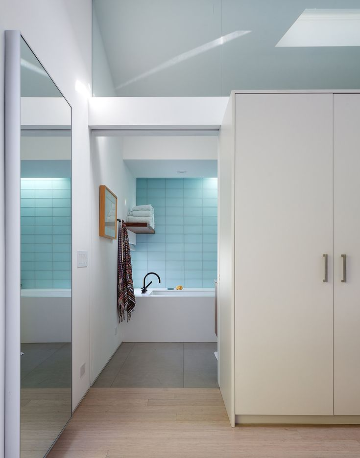 Home Renovation for a Modern Family in Bel Air - The New York Times. Mr. Holden added glass tile to the master bathroom, which, in tandem with a skylight, helps make the space appear more luminous. Photo by Trevor Tondro.