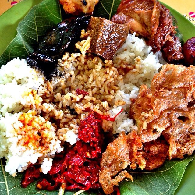 """Sega jamblang, also known as nasi jamblang or rice jamblang in English, is a typical food of Cirebon, West Java Province. """"Jamblang"""" comes from the name of the region to the west of the city of Cirebon, home of the food vendors. Characteristic of these foods is the use of teak as a pack of rice leaves. The dish is served via a buffet, menus are usually available which include fried tempeh, tofu vegetables, jambal fish, lung (troop), scrambled eggs and sambal."""