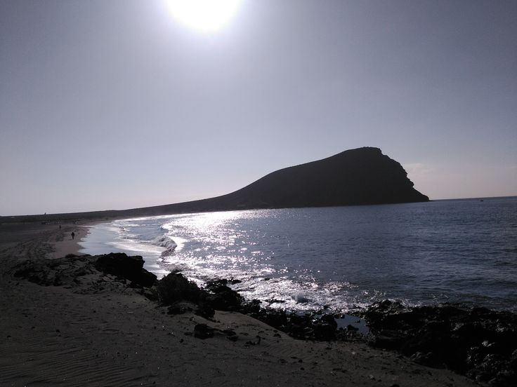 Camping on the beach at world famous Montana Roja (Red Rock) on La Tejita Beach next to El Medano in the south of Tenerife. Book your bungalow today!