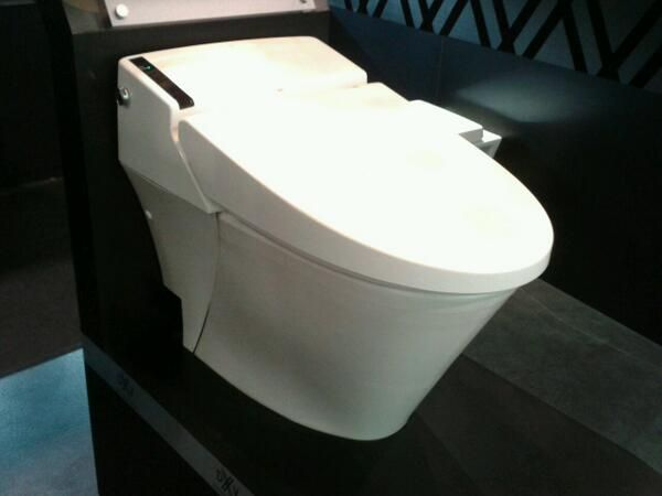 American Standard's new DXV line with remote control auto toilet that does it all - even cleaning you & itself #IDS14