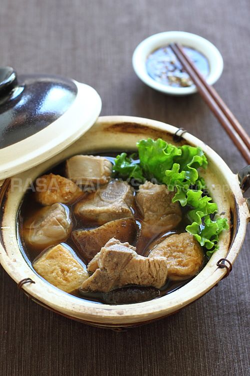 Bak Kut Teh (Pork Bone Tea Soup) recipe - Infused with herbs such as Dong Quai, Cinnamon, Star Anise, and loaded with pork ribs, dried Shitake mushrooms, tofu puffs, and heaps of garlic, this soup fills the kitchen with evocative scents. #malaysian #soup #pork
