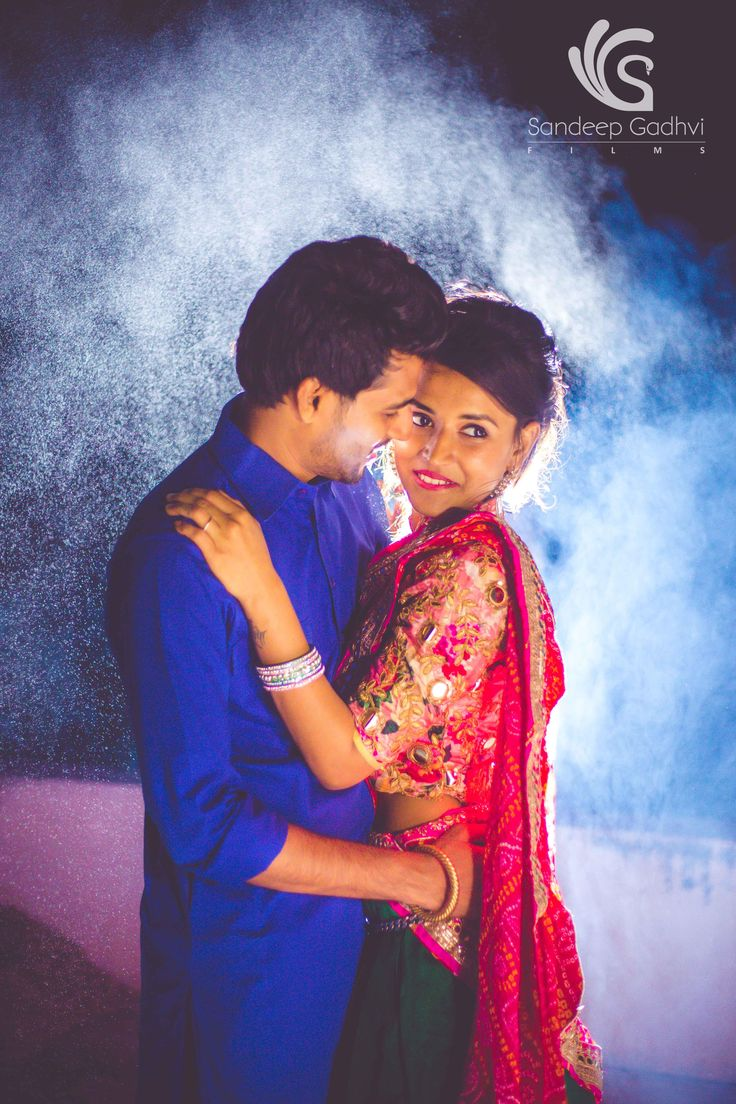 Images backlit with flash and having anything in between like raindrops, fog, smoke will make picture stand out and give that dreamy look to it. The smoke coming from bottom of the terrace where the cooking was done mixed with the white spray that we used gave a beautiful blue backdrop for this image combined with a contrasting forground of bride and groom in colorful desi rajasthani attire.