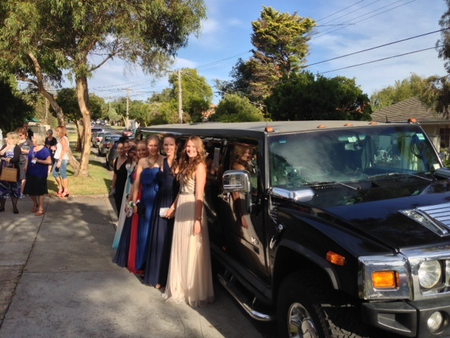 A year 12 Formal group in front of our black hummer limousine. No.2