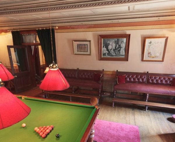 The billiard room with the mahogany billiard table and beautifully painted ceiling.