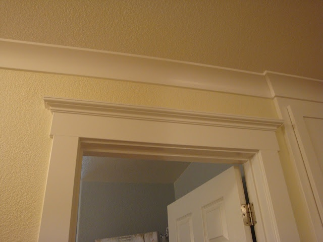 COVE MOLDING:  This room looks like the ceiling was just a put on.  Cove molding is the top wall and the ceiling is decorated into one piece.
