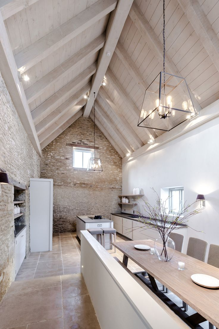 Pale exposed brick & cream timber cathedral ceiling over kitchen & dining space Sims Hilditch Design Studio at The White Hart