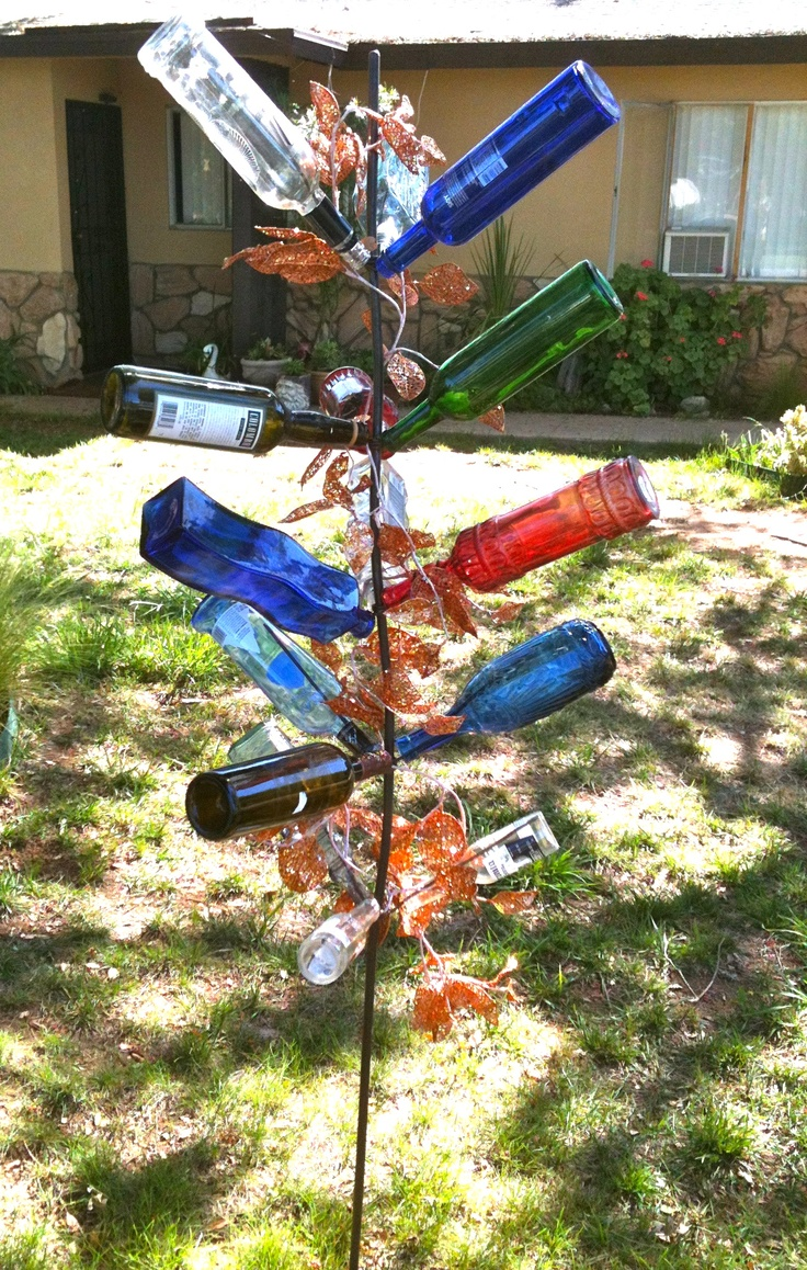 How to make glass yard art - Creative Way To Use A Glass Bottle To Make Yard Art