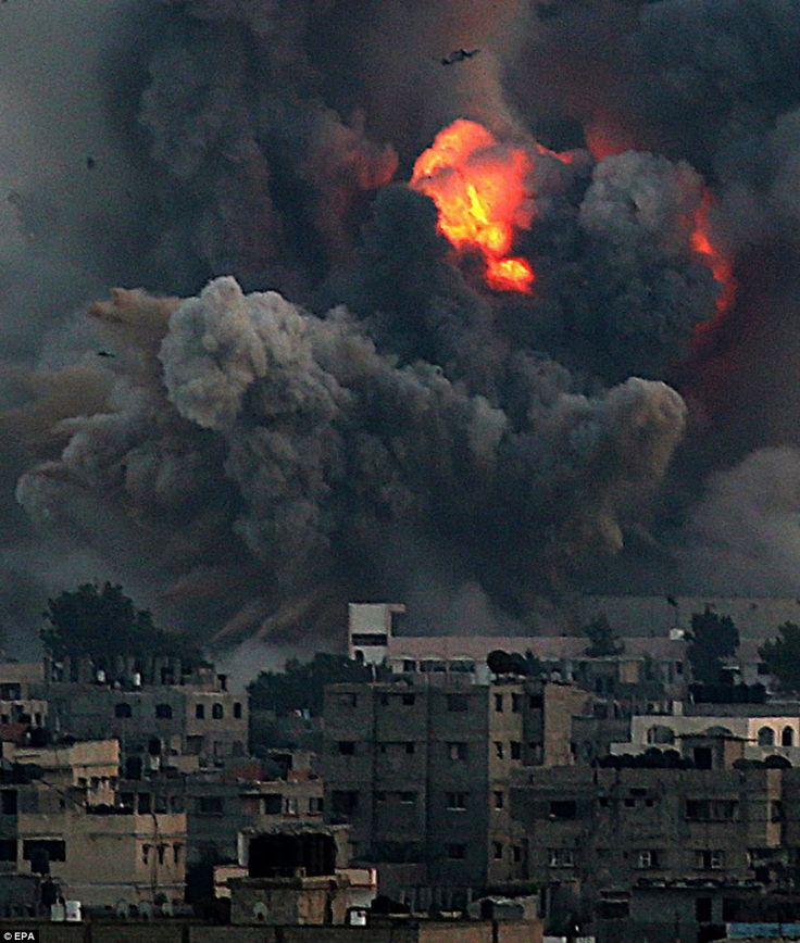 An explosion on the Gaza Strip as one of the 100 sites targeted by Israeli forces goes up in flames