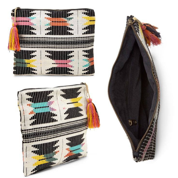 Multi-colored woven fabric clutch with a soft tassel and top zipper closure.