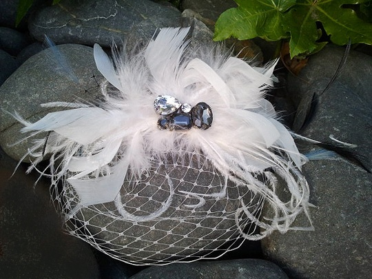 Petite veil birdcage with floaty white feathers and smokey glass jewells.