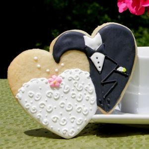 These bride and groom cookie favors are so fun!