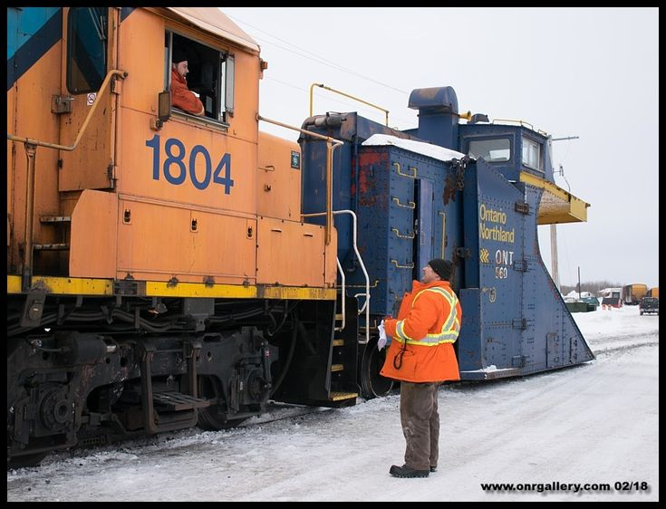 A short staff meeting takes place between Plow Foreman Wade and Engineman Mark at Cochrane Yard before departing for some snow clearing on the Island Falls Sub. February 17th.