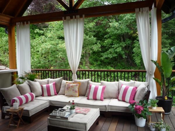mtrachi: Outdoor living space  white and pink striped pillows and outdoor furniture.