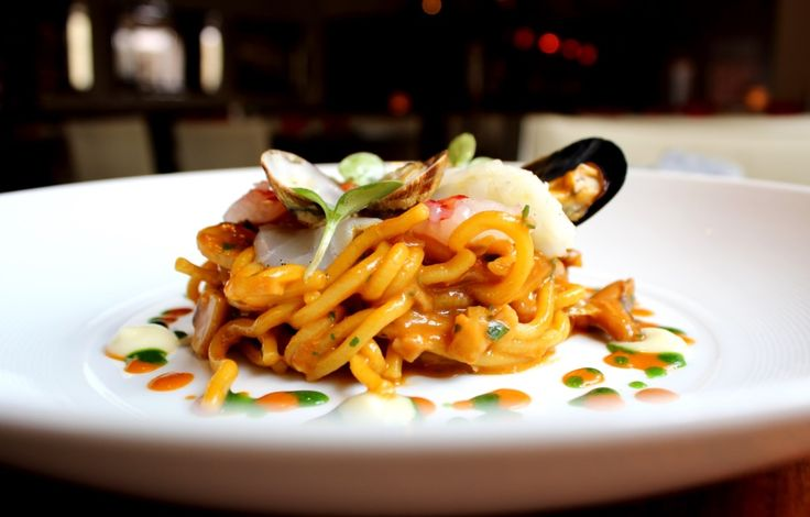 Spaghetti chitarra emulsified with fish soup, perfumed with sea urchin, marinated fishes and light garlic cream