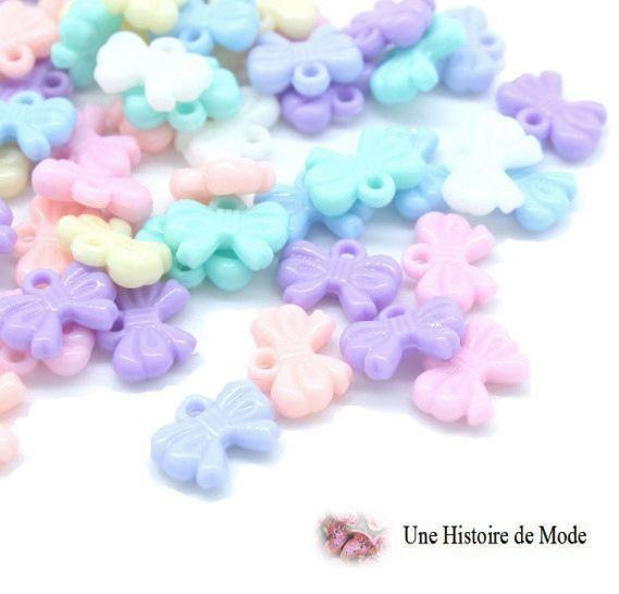 Lot de 20 breloques pendentifs noeuds - acrylique - couleur pastel 9 x 12 mm : Nœuds par une-histoire-de-mode