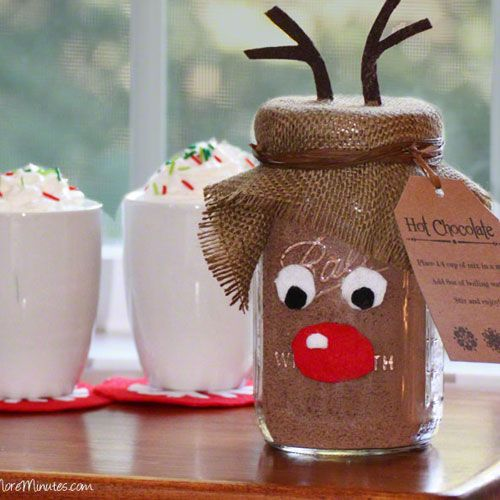 You might not know by looking at it, but this reindeer Mason Jar Hot Chocolate Mix is filled with hot chocolate mix, turning it into a sweet gift and cute decor.