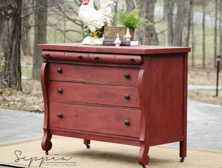 This empire dresser was beautifully painted by Seppia Furniture in Primer Red Chalk Paint® by Annie Sloan. It was then sealed with a Dark Chalk Paint Wax finish for a gorgeous finish!