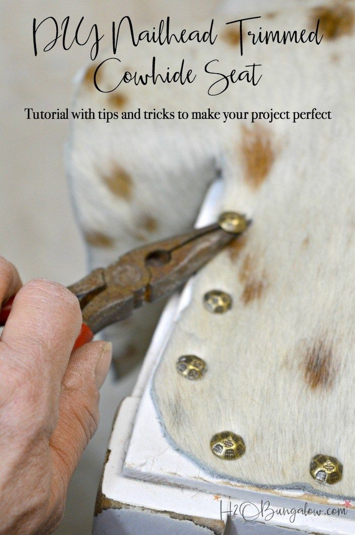 Tutorial and tips to make a DIY nailhead trimmed cowhide seat. Take an old wood seat on a bench or chair and transform it to an upscale and trendy cowhide piece of home decor. Depending on the piece you use it will look great in a farmhouse or modern home!