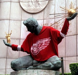 The Spirit of Detroit with a red wings jersey... They do this with the Pistons and the Lions and the Tigers as well...