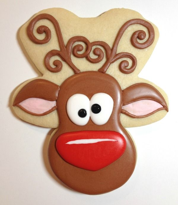 Whimsical Reindeer Cookies using gingerbread man cookie cutter. I love the large red nose on this one.