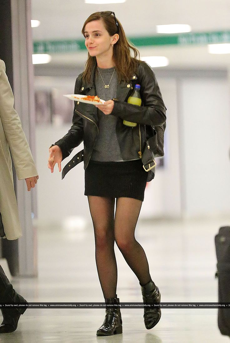 Emma Watson enjoys a slice of New York Pizza on her way out of JFK airport in NYC on January, 10.