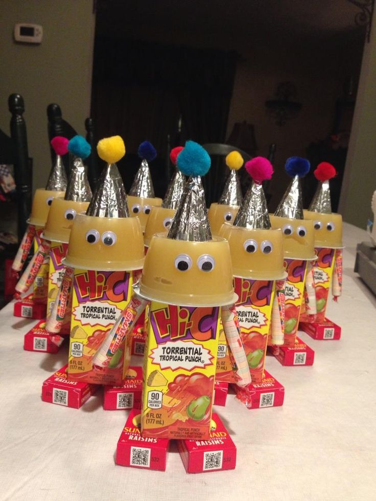 Birthday Bots! A healthy cute snack for school Birthday celebrations!  materials used:One applesauce cup,one Juice box, two raisin boxes.two smarties candy, one cupcake wrapper,googlie eyes and one pom pom.Hot glue to attach.