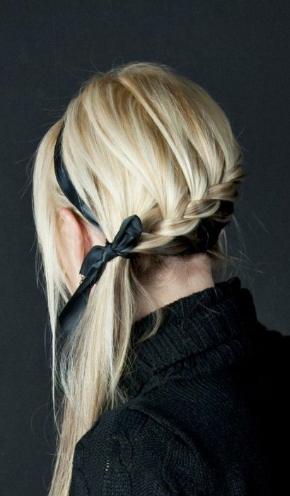 blonde braid, black ribbon... Maybe have a messy bun at the bottom?
